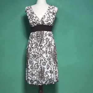 Cream and brown floral dress. Size M.
